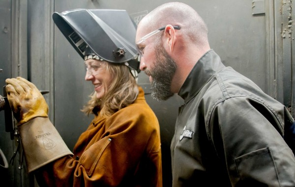 Brad Dorschel, Master Welder and SDCE faculty member instructs Andrea Cook, SDCE student during Shielded Metal Arc Welding project