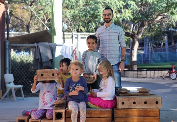 (Photo Courtesy of Rhett S. Miller/U C Regents) SDCE Graduate Simone Scano leads outdoor activities with UC San Diego Early Childhood Education Center