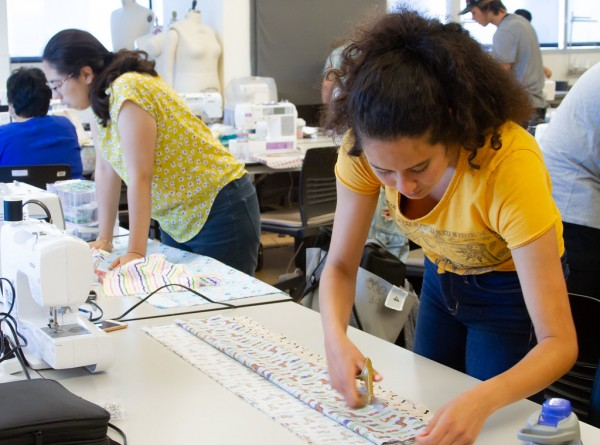 Students at San Diego Continuing Education make pillowcases for local foster youth