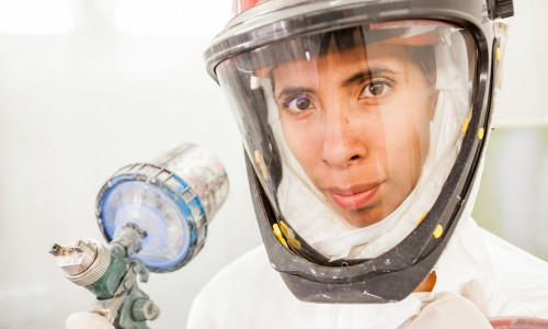 Student Elizette Garcia finishes project inside SDCE's Auto Body and Paint Garage